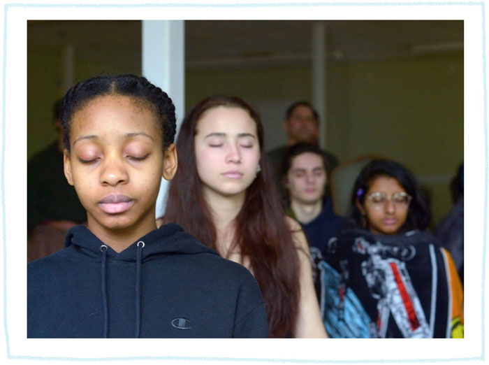 Teen group meditating