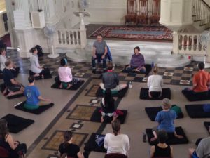 Group meditation in large hall