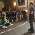 Teen speaking to group durring Northeast New Year's Teen Retreat