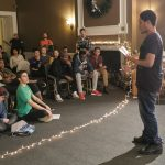 Teen speaking to group durring Northeast New Year's Teen Retreat