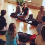 Group meditation in hall
