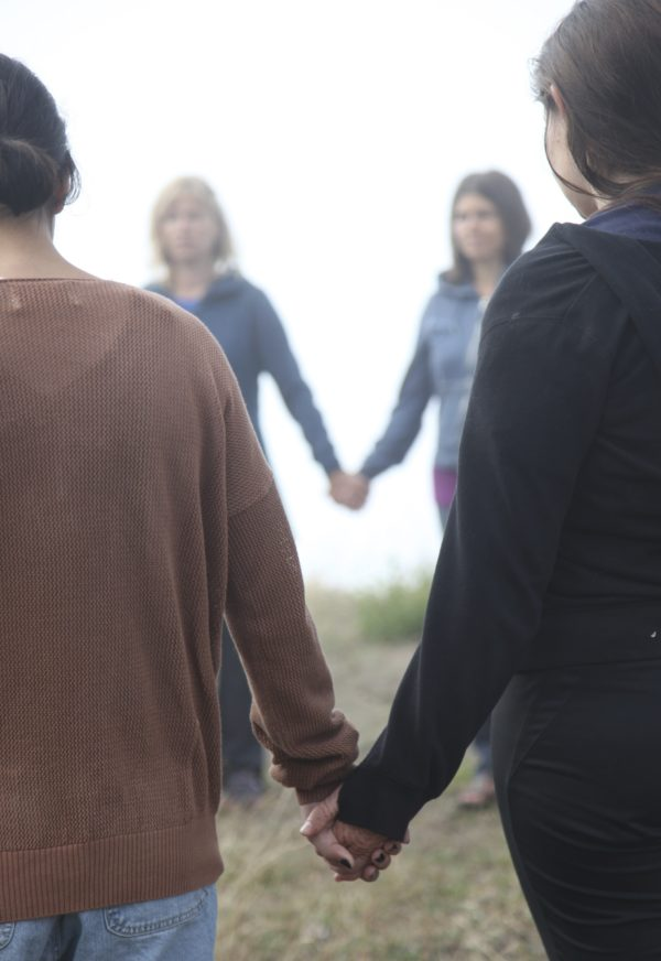 Retreat participants in a circle holding hands