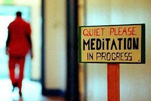 Quiet please meditation in progress sign in hallway
