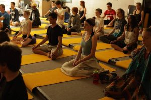Teens in group meditation