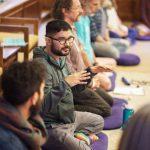 Man talking to group of meditators