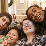 Four teens sitting on the couch