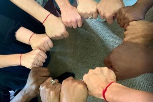 Group with hands in circle