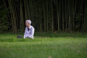 Participant sitting in grass