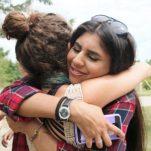 Retreat participants hugging