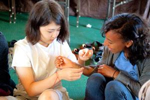Participants tying bracelets