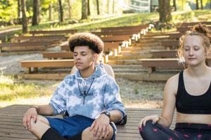 Teens meditating on retreat