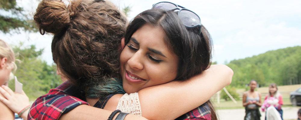 Retrat participants hugging